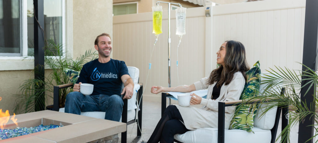 girl and guy getting iv therapy